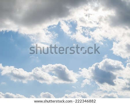 Blue sky with clouds, possible background use. - stock photo