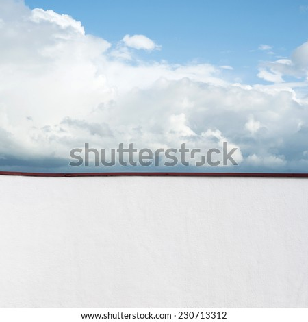 Blue sky with clouds, view from the balcony - stock photo