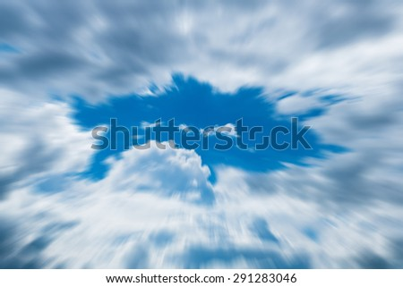 Blue sky with clouds, zoom motion blur  - stock photo