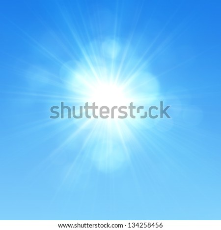 Blue sky with glaring sun - stock photo