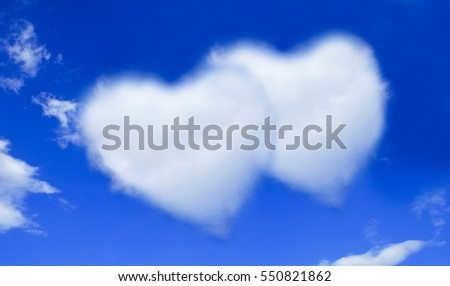 blue sky with hearts shape clouds. Valentine's holiday background.