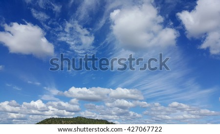 blue sky with lots of awesome clouds - stock photo