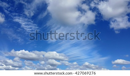 blue sky with lots of white clouds - stock photo