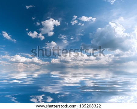 Blue sky with majestic clouds and sun reflection in water, for design - stock photo