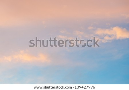 Blue sky with pink clouds - stock photo