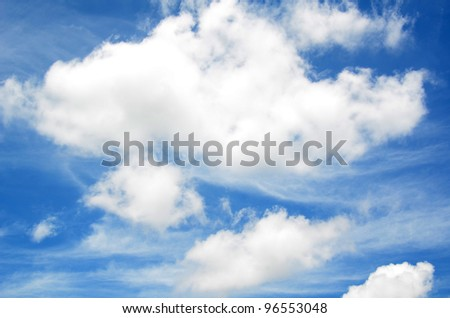 Blue sky with puffy white clouds. - stock photo
