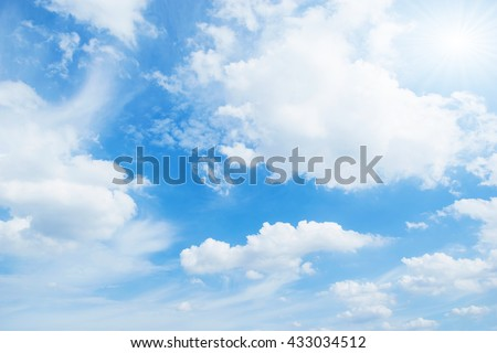 Blue sky with white clouds floating in the sky. - stock photo