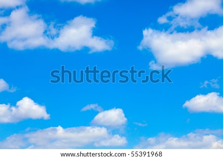 blue sky with white fluffy clouds background - stock photo