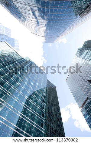 Blue Skyscrapers on sky background - stock photo