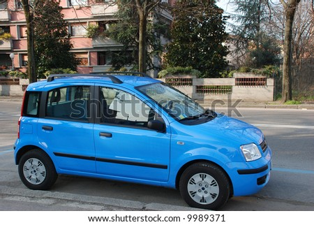 Blue small car on the street - stock photo