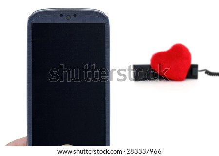 Blue smartphone and blurred telehone with heart. Idea for Valentines Day calls, love, lovers, love apps, Internet, blogs and others. - stock photo