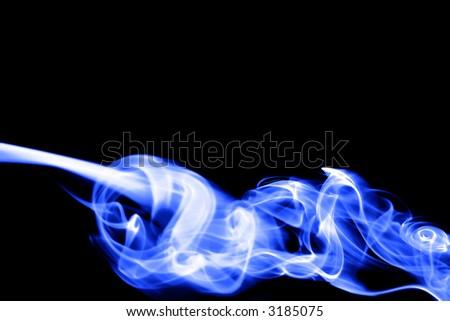 Blue smoke trails, with black background. - stock photo