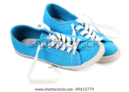 Blue sneaker on a white background - stock photo