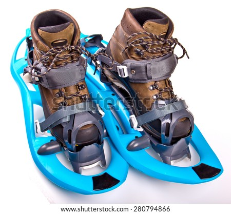 Blue Snowshoes partly isolated on white background - stock photo