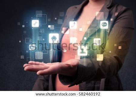 Blue social application icons in the hands of young casual businesswoman