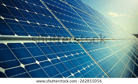 Blue solar panels and sun light - stock photo