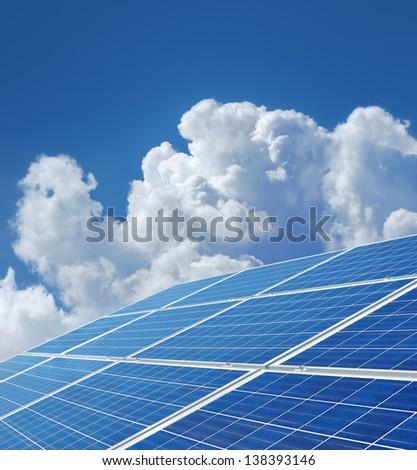 Blue solar power panels generating renewable energy - stock photo