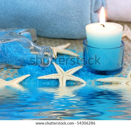 Blue spa with candle and seastar - stock photo