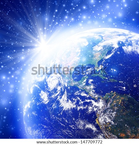 Blue space with the world and sunrise, Earth globe image provided by NASA  - stock photo