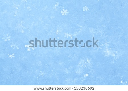 Blue sparkling snow background with white little snowflakes. - stock photo