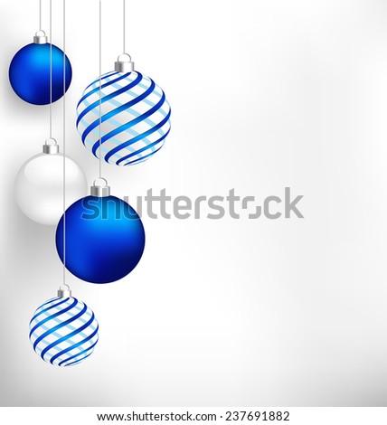 Blue spiral christmas balls hang on white background - stock photo