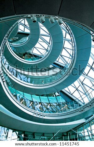Blue spiral stairway in the middle of building - stock photo