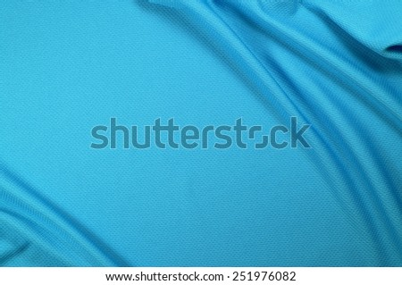 Blue sport shirt clothing texture and background - stock photo