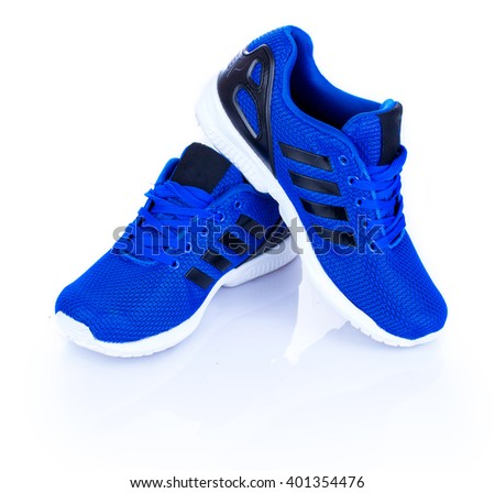 Blue Sport shoes. Running shoes, jogging shoes on a white background with reflection - stock photo