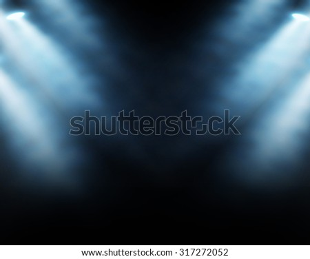 Blue spotlights on a dark background, abstract - stock photo