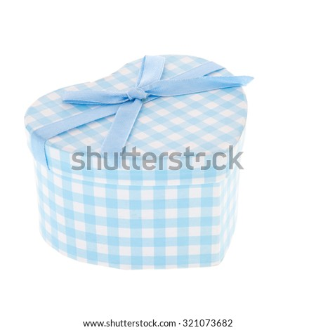 Blue spotted gift box isolated over white background - stock photo