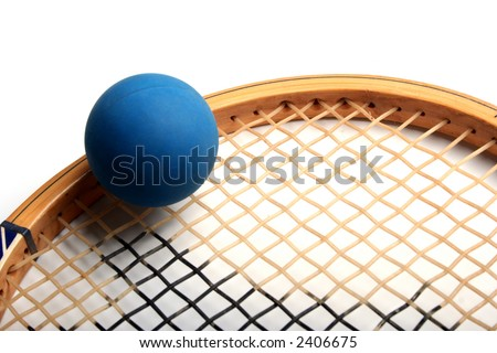 Blue Squash Ball on top of Racquet - stock photo