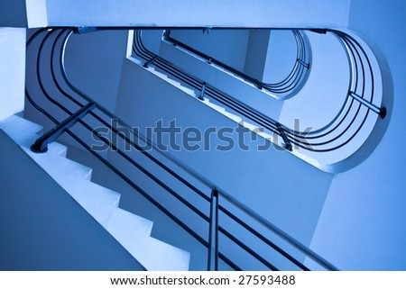 Blue staircase in office centre - stock photo