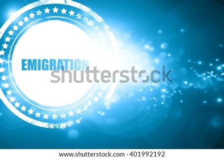 Blue stamp on a glittering background: emigration - stock photo