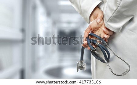 blue stethoscope and hands  - stock photo