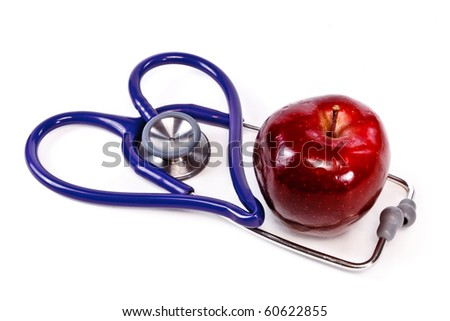 Blue Stethoscope in the shape of a heart with a red apple - stock photo