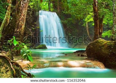 Blue stream waterfall in Kanjanaburi Thailand (Erawan waterfall national park) - stock photo