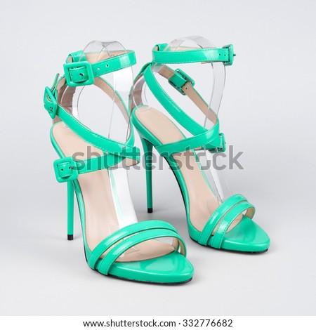Blue summer sandals over white  - stock photo