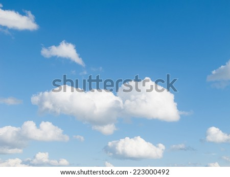 Blue Summer Sky, with Clouds, possible background use - stock photo