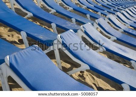 blue sunbeds pattern - stock photo
