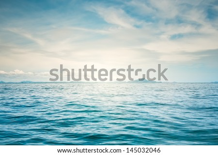 Blue sunny sea and cloudy blue sky - stock photo