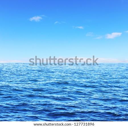 Blue sunny sea and soft sky - stock photo