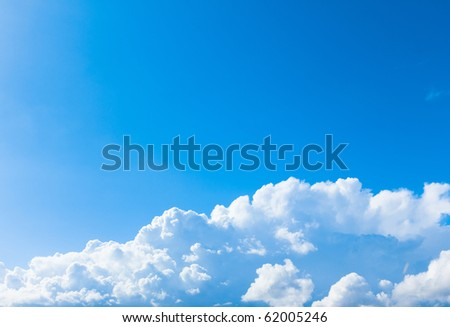 Blue Sunny Skies with Clouds - stock photo