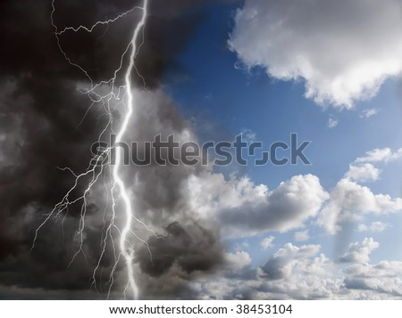 blue sunny sky and black clouds with lightning - stock photo