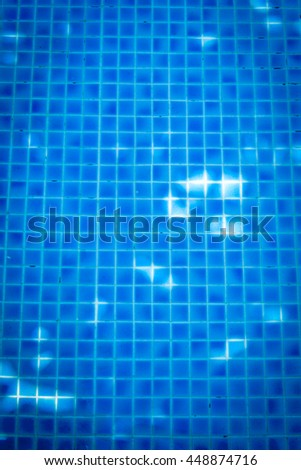 Blue swimming pool wall texture and background