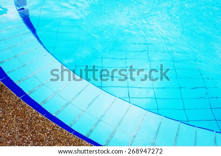 Blue Swimming Pool with Pure Transparent Water. Summer Rest.  - stock photo