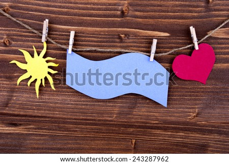 Blue Tag Or Label With Sun And Heart On A Line With Copy Space Or Your Free Text Here On Wooden Background, Two Symbols, Vintage, Retro And Old Fashion Style - stock photo