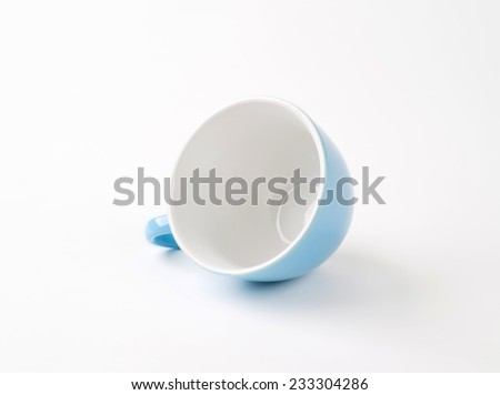 blue tea cup on white background