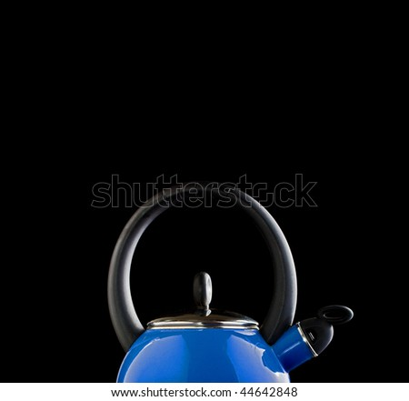 Blue teapot on black background