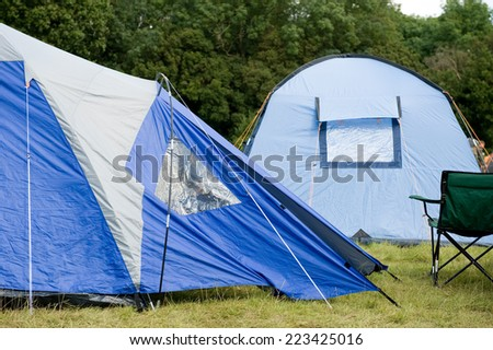 Blue Tents At Campsite - stock photo