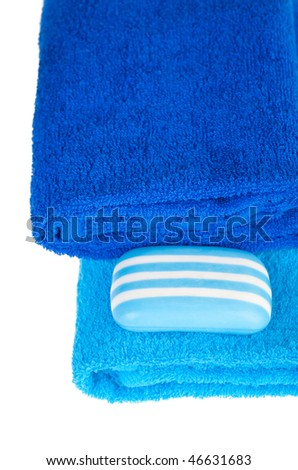 blue terry towels and soap on white background. Isolated.